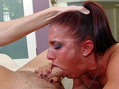 This cum addicted babe, who is wearing nothing, is dedicating all her attention to please her guy's man meat. She knees down, grabs that cock and stuff it between her lips, to suck it. This long haired bitch is enjoying every inch of that hot rod, as it goes deep in her pretty mouth again and again.
