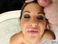 Lisa Sparkle is a vicious brunette slut ready to suck off five horny guys with her perversely skilled mouth. Then it's time for her face to be covered by five cumshots.