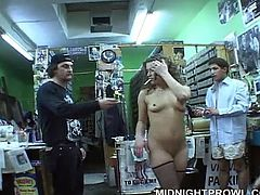 Curvy brunette whore shows off her slender body while sitting totally naked in front of horny dudes in grocery store what literary drives them crazy in gangbang sex video by Pornstar.