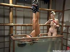 Hot chick Veronika loves to swim, so she asks her GF to fuck her coochie with a dildo while she is bathing in this big aquarium.
