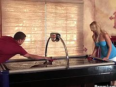 Brianna Beach is bored of playing games, so she decides to use that table for getting laid. The cumshot lands on her tongue.