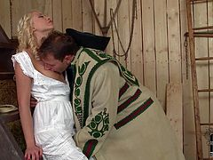 Lovely village blonde Lindsey Olsen in long virgin white dress is a heartbreaker. She bares her tits and and gives head to handsome guy before he drill her pink pussy from behind.