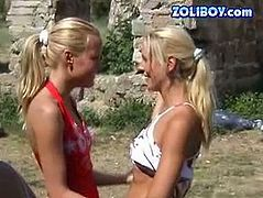 At the start one kinky blonde teen takes a piss exposing her meaty pussy. Later two hot curvy girls bend over the rock wall showing off their tender asses.