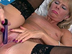 Be ready to hear this mature blonde moan as you watch this solo video where the horny Cathy Oakley masturbates with a dildo.