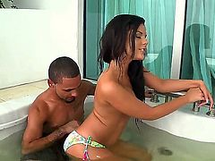 Tempting young brunette Madison Parker with natural boobs and delicious ass in bikini has fun teasing horny dude in jacuzzi and plays with his meaty cock in living room.