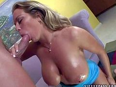 Horny babe Amber Lynn bares her huge tits and spreads her legs in front of her fuck buddy. He plays with her wet massive hooters and licks her snatch before she gets throat fucked.