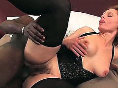 Precious blonde with natural medium boobs Magda getting passionately fucked in her hairy twat by her strong black fucker.