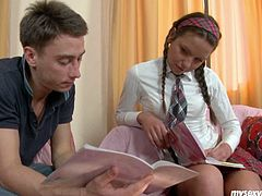 Cute Russian chick Zufia is looking sweet and sexy in college uniform. Horny guy fingers her wet tight pussy upskirt so the girl moans seductively.