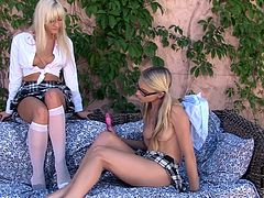 Lustful babes wearing college uniform are hell seductive chicks. They place on a couch outdoor pleasing one another sensually. Damn, these girls blow my mind and make my cock hard as hammer.