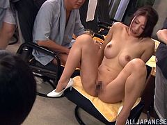 Horny Japanese girl in a swimsuit makes hot show. She poses for the camera showing her hot boobs and nice ass.