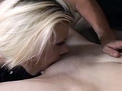 Spoiled tattooed dark haired bitch lies on the couch with legs wide open getting her shaved tiny vagina tongue fucked by messy blond whore in peppering lesbian sex video by Fame Digital.