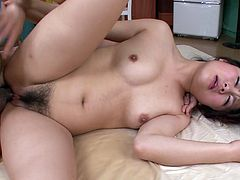 Hot blooded Japanese cutie gets her hairy pussy drilled in missionary style while her mouth is busy giving blowjob to aroused wanker before she keeps fucking in missionary style in sultry MMF sex video by Jav HD.