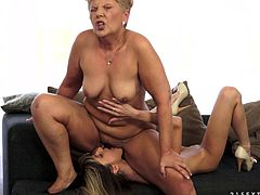 Salacious blonde granny seduces a blonde girl and undresses her. The ladies lick each other's cunts devotedly and then show their scissoring skills.