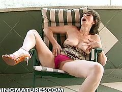 This mature lesbian was toying her hairy pussy when a young hottie saw her and decided to help her with her fist.
