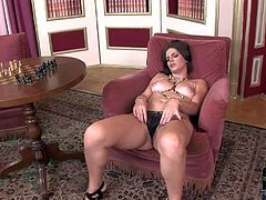Lovely brown haired lady Bobbi Starr with natural tits and nice ass pulls off her black thong panties and then plays with her hairy snatch. She cant keep her fingers off her bush.