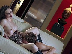 Tiffany Tyler is a beautiful brown haired babe with long legs and perfect boobs. Chick in barley there dress and high black boots gets her pussy licked and fucked by her man on the couch.