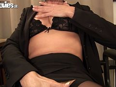 She is horny granny that loves young men with hard dicks. During the work she gets horny so she starts masturbating right in the office. She seduces her subordinate for sex so she sucks his dick deepthroat.