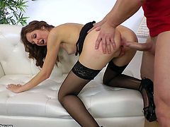 Ardent though pale brunette in black stockings thirsts for orgasm. She bends over the couch and smacks her rounded pale and flossy ass. Then horn-mad bitch begs to drill her anus as tough as possible in a doggy style.