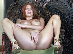 Sabrina Maree is a well-endowed glamorous beauty withs sexy long legs and juicy needy pussy. Gorgeous lady in high heels shows off her nice body as she rubs magic wand against her snatch.