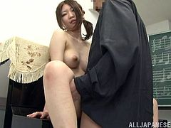 Hot Japanese girl strips her clothes off during a private music class. Then she gets her pussy fingered. Later on this babe gets face fucked.