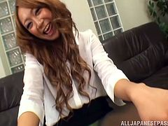 Sexy Japanese office girl is having fun with her man. She rubs her nice feet against the dude's schlong and seems to enjoy it much.