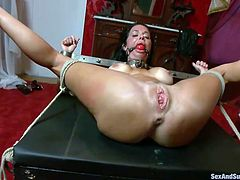 Veronica Avluv is a beautiful milf who needs to be taken advantage of. James ties her up in the living room and puts a ball gag in her mouth so she can't call for help. Her arms and legs are both spread and James sticks his hard dick inside her anus. He gives her a super hard fuck in her asshole.