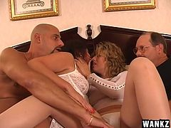 These two guys decide it would be a good idea to swap wives for the night, but things turn into an orgy instead. The men watch as their wives make out with each other and lick each other's nipples. Watch as the ladies eat pussy.