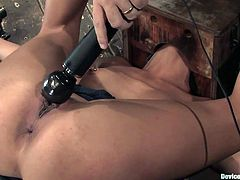 A hot brunette slut gets her asshole fucked by a fucking device in this kinky bondage scene right here, hit play and check it out!