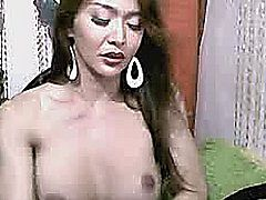 A very horny tranny jerks off her big hard dick right in front of your eyes. Really hot asian shemale undress in front of the webcam and masturbates her cock till he gets orgasm.