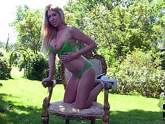 Eye-popping blonde Lexi Lowe with perfect big melons strips down to her panties in the garden. She shows off her amazing boobs and rubs her pink pussy with her green panties on outdoors.