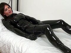 Do you have fetish for latex costumes? If yes, this is the right video for you to watch. Slutty girl wears black latex costume masturbating on cam. The she has lesbian sex with the girl wearing harness so she gets nailed bad with artificial dick.