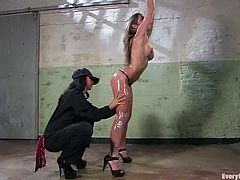 Hot blonde chick with big boobs gets tied up by brunette Isis Love. After that she gets her ass toyed and fucked with the strap-on.