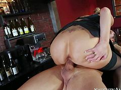 Curvy drunk lady Katie Kox with bubble butt and huge tits feels horny at the bar. She pulls out guys meat pole and then takes it. She gives head and then bounces on cock on bar counter.