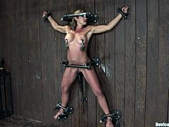 Feast your eyes on this blonde's sensational body as she tied up and tortured as well as being masturbated.
