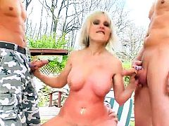 Busty milf goes wild in threesome