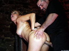 Salacious brown-haired chick having handcuffs on her hands and legs gets her mouth pounded hard by some horny man. Then the guy drills her vag doggy style.