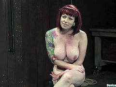 A redhead big titty bitch with tattoos gets tied up with devices and abused in this hot bondage scene right here, check it out!