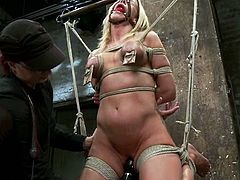Breast bondage is not the only unpleasant thing that happens to this delightful cheerleader. Honey gets some other ways of torture too.