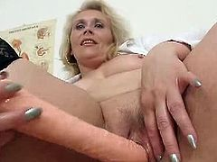 This blonde nasty cougar brought her vibrator with her at the clinic. She masturbates when the doctor is out.