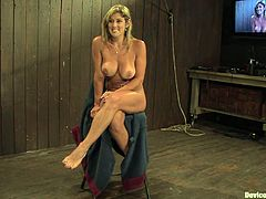 See the sexy blonde with very nice and full boobs getting her pussy and nipples tortured while she's tied up in this wild BDSM video!