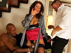 Strict looking brunette MILF sits between two beefy dudes during business negotiations. They stroke her body from both sides before she inclines to sturdy black penis to give blowjob while getting her cunt tickled with vibrator.