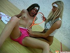 Two sporty chicks lick each others shaved pussies and dildo fucks each other on the court. One sucks nipple sand finger fucks her girlfriend's snatch.