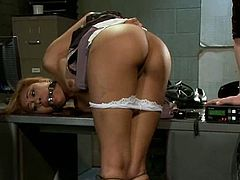 Sexy Latina strips her clothes off and gets tied up by horny brunette. After that she gets her pussy toyed with a dildo and a vibrator. She also gets toyed with the strap-on from behind.