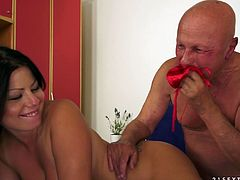 This old dude is going to smell this brunette babe's red panties and then leave a creampie in her snatch after she sucked his cock.