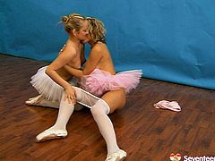 Arousing ballerinas are looking hot wearing tutu skirts. They both are going kinky and nasty using big sex toy in a hot lesbian fuck session.