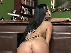 Smoking hot black haired stunner Claudia Capri with round perfectly shaped hooters and pierced belly button in shire stockings only teases and stuffs shaved wet cunny with dildo on the floor.