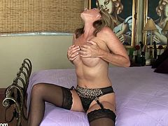 A blonde fucking slut gets naked and starts fingering her wet pink-ass snatch for the camera in this hot solo scene right here!