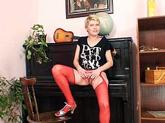 Be pleased with kinky milf who likes to satisfy her pussy with dildo toy. She spreads her red stockings legs wide and dildo fucks her pussy.