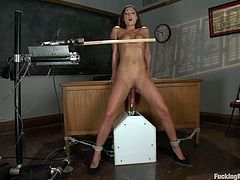 Sexy brunette girl takes her clothes off in a classroom. She gets her pussy toyed with a vibrator by some guy. She also gets drilled by the fucking machine.