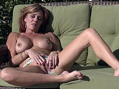 A mature fucking whore gets naked outdoors, spreads her legs and fucking fingers her dirty-ass snatch, check it out right here!